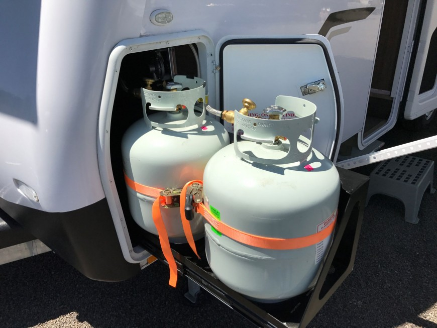 Portable gas cylinders restrained in campervan