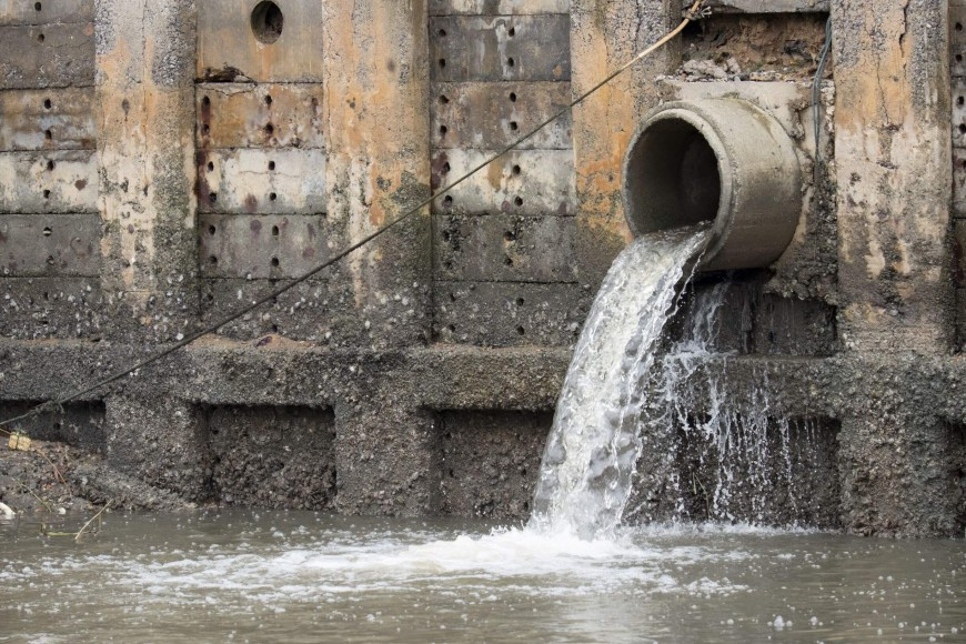 Stormwater outflow pipe discharging into waterway