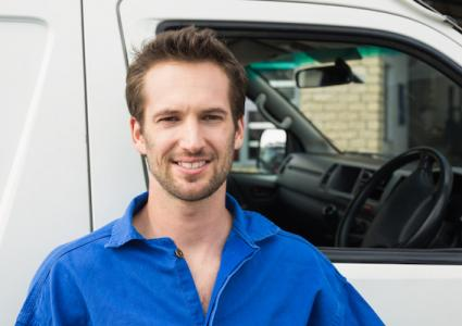 A smiling young man is standing by his white delivery van 000063273933 XXXLarge1 copy